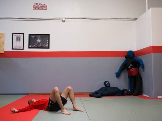 Ross Voit rests on the ground during practice on Monday, February 20, 2017 at American Kenpo Karate & Shootfighting in Bonita Springs. Famed kickboxer, MMA fighter and professional wrestler, Bart Vale, trained the studioÕs owners, father and son Barry and Austin Polonitza. Vale will host a seminar on Saturday at the studio.