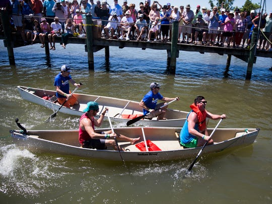 Racers in the Tippycanoe VIP Sprint Race collide at