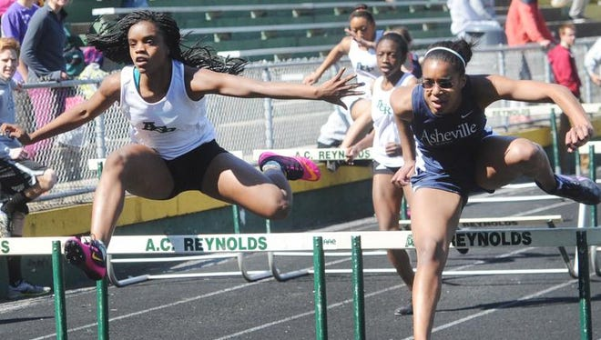 Athletes compete in the girls 100-meter hurdles at last week's Buncombe County track meet at Reynolds.