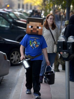 Kyle Linn trick or treats in his Minecraft costume in downtown Great Falls last year.