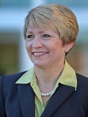 New Ivy Tech Community College president Sue Ellspermann smiles during an interview between greeting greets students on the first day of fall semester classes, Monday, August 22, 2016, outside the Glenn W. Sample North Meridian Center.
