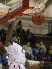 Lawrence North's Tony Perkins (12) slams a dunk during