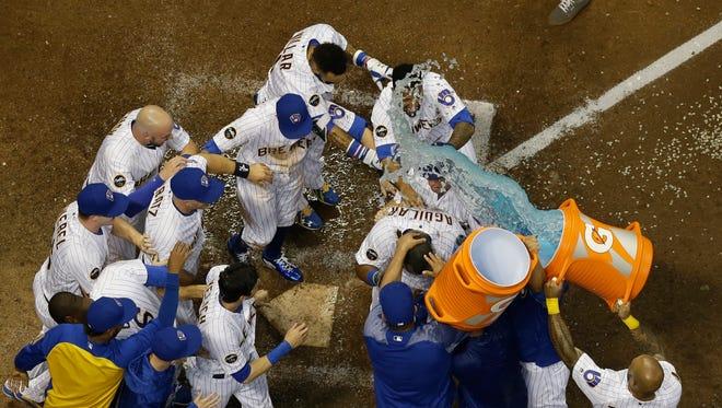 Jesus Aguilar celebrates his walk-off home run.