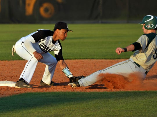 (l-r) Michael Sandle, No 8 of the Navarre Raiders, gets the out at second base on Ben Bryan, No. 9, of the Lincoln Trojans during their Region 1-7A quarterfinal game Thursday evening at Navarre.