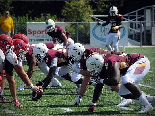Salisbury's defensive front gets ready for a play against Montclair State on Saturday, Sept. 17 at Sea Gull Stadium in Salisbury.