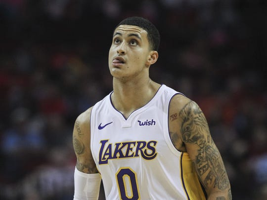 Los Angeles Lakers forward Kyle Kuzma (0) reacts after