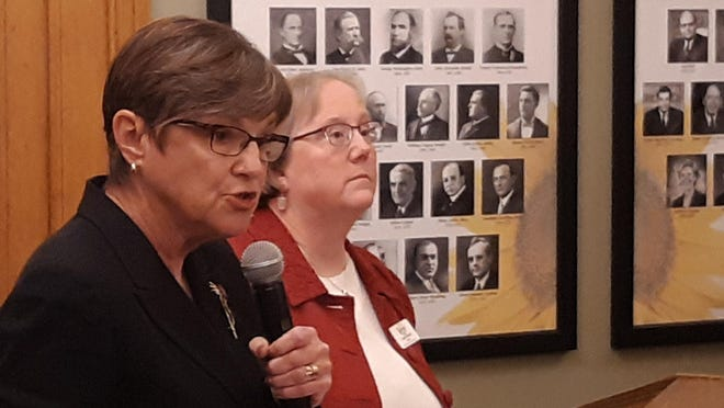 Gov. Laura Kelly, left, and Kansas Department for Aging and Disability Services Secretary Laura Howard announced a state hospital employee died last week of COVID-19.