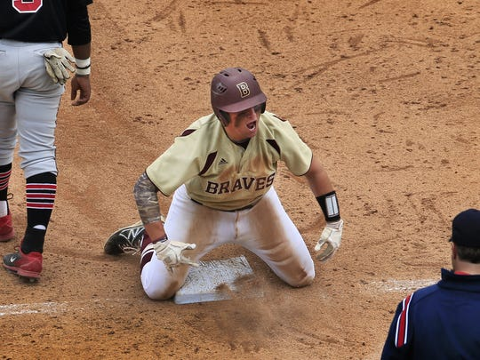 Eric Petruzzi played high school baseball at Brebeuf. In this photo, he celebrated a two-run triple during a win over North Central in the Marion County baseball tournament at Victory Field in May 2014.
