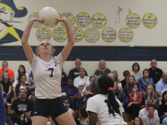 Sneads senior Alyssa Stagner sets a ball during a senior-night volleyball game on Tuesday.