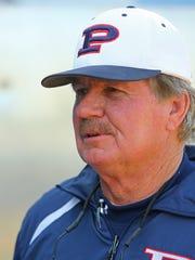 Pinnacle High baseball coach Roy Muller works with