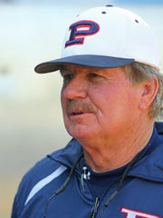 Pinnacle High baseball coach Roy Muller works with