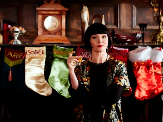 """This photo provided by Acorn TV shows, Essie Davis as Phryne Fisher in the episode """"Murder Under the Mistletoe"""" of series 2 """"Miss Fisher's Murder Mysteries,"""" on Acorn TV."""