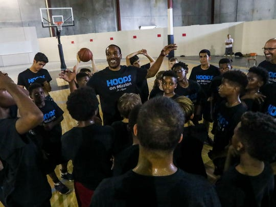 Dwayne Jackson, founder of Hoops On Mission, tries