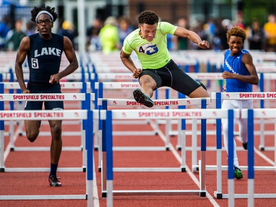 Michah Joseph-Young (No. 4) races to a first place finish in the Division II Boys 110 Meter Hurdles event at the DIAA Outdoor Track and Field Championships at Dover High School in Dover on Monday evening.