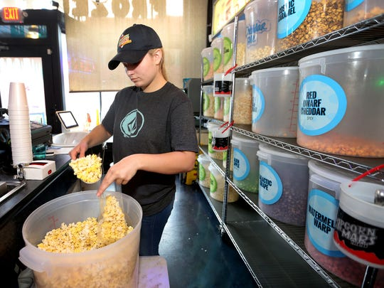 Halley Stansberry bags an order of popcorn at Frozen
