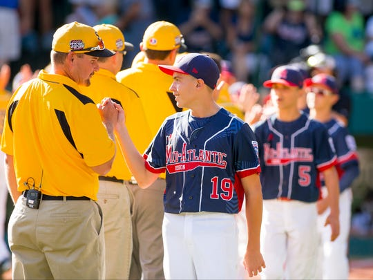 Goodlettsville coach Joey Hale, talks with Maine-Endwell's Ryan Harlost after Maine-Endwell defeated them 3-0, Monday at the Little League World Series in Williamsport.