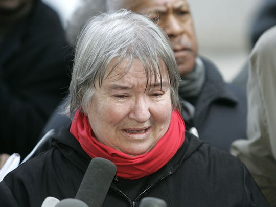 Attorney Lynne Stewart cries as she speaks to the press