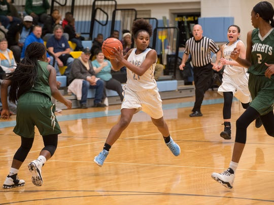 Cape Henlopen's Alexis Watkins (21) passes the ball through Mount Pleasant's defense in the first round of DIAA Girls Basketball Tournament at Cape Henlopen High School.