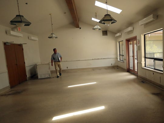 Construction manager Robert Baglio makes his way around the old Kitsap Recovery Center building in East Bremerton on Thursday, July 20, 2017. The building is being renovated and turned into the Kitsap County Crisis Triage Center.
