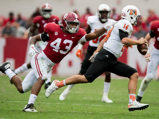 Alabama linebacker VanDarius Cowan (43) stops Mercer quarterback Tanner Brumby (14) in second half action at Bryant Denny Stadium in Tuscaloosa, Ala. on Saturday November 18, 2017. (Mickey Welsh / Montgomery Advertiser)