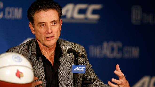 Louisville basketball coach Rick Pitino answers a question at the Atlantic Coast Conference NCAA college basketball media day in Charlotte, N.C., on Wednesday.