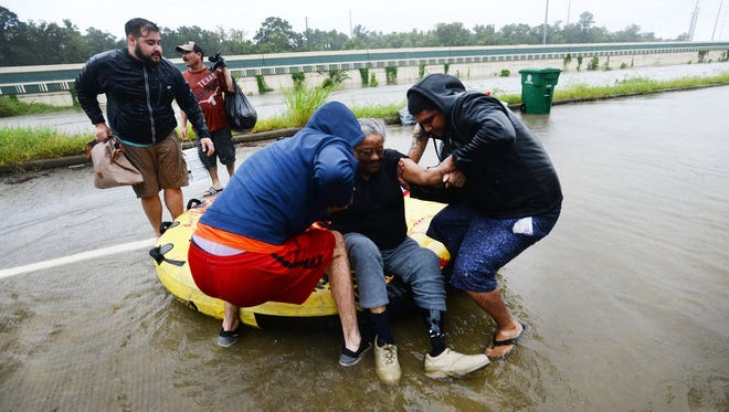 Pearl Lyons is rescued from her subdivision in Houston in the aftermath of Hurricane Harvey, Aug. 28,2017.