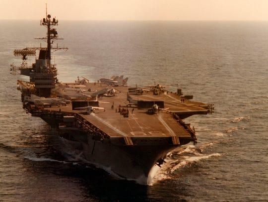 Historical photos of USS Forrestal provided by National Naval Aviation Museum.