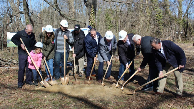 The Gonzalez family breaks ground at the site of their future home with the help of Assemblymen Bob Andrzejczak and R. Bruce Land, Mayor Anthony Fanucci, and Cumberland County Habitat for Humanity officials.