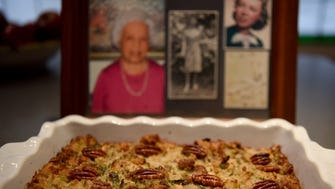 Pictures of Christine Griffo are shown behind Joan Banez's  cornbread, apple, and pecan stuffing. Banez has been making her mother's stuffing recipe as long as she can remember.