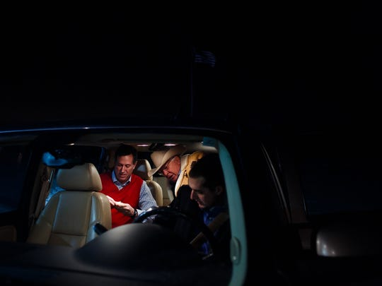 Republican presidential candidate Rick Santorum and supporter Foster Friess, climb into their car to head to Santorum's first event of the day in Williamsburg at 6:45 a.m. Tuesday, Jan. 26, 2016.  Santorum spent the night with friend and supporter Steve Boender in Oskaloosa.