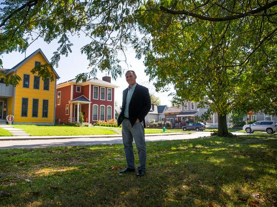 Patrick Dubach, president of the Re-Development Group, poses for a portrait by homes his company developed near Highland Park on Friday, Oct. 13, 2017. Dubach is also the president of the Holy Cross Neighborhood Association. He lives in the neighborhood and his company has developed many houses there.
