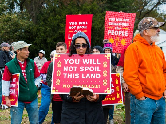 People gathered on the property of the Adorers of the Blood of Christ to protest construction of a natural gas pipeline across their Lancaster County land.