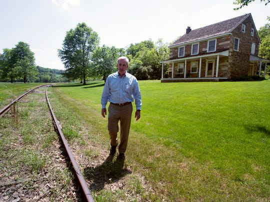 Tim Kinsley walks in front a 200-year-old house built by Felix Glattfelder, whose descendants founded Glatfelter Paper Company. The house was preserved by the Kinsley family.