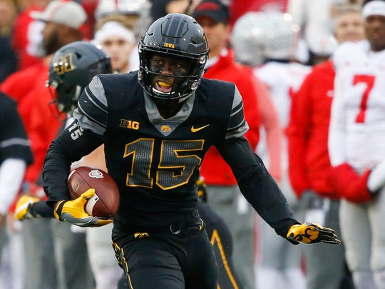 Iowa defensive back Josh Jackson returns an interception during a game against Ohio State at Kinnick Stadium on Nov. 4, 2017.