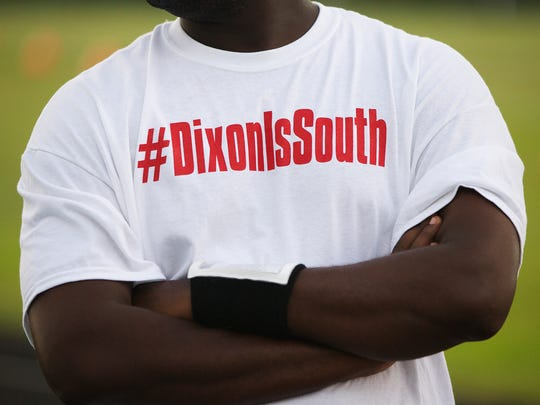 South Fort Myers High School assistant football coaches wear #DixonIsSouth shirts before Friday's (8/19/16) game against Largo at South Fort Myers High School. The shirts were worn in support of former South Fort Myers head football coach Anthony Dixon who was fired recently. The game on Aug. 19, 2016 was cancelled due to extreme rain and lightning.