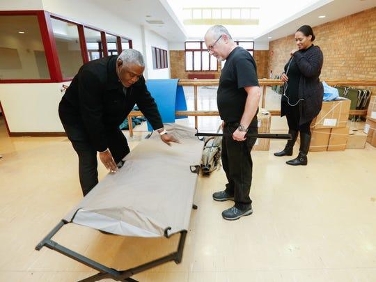 Helping Hands executive director Ya'el Williams, left,
