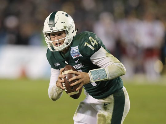 Michigan State quarterback Brian Lewerke runs during the fourth quarter of MSU's 42-17 win over Washington State in the San Diego County Credit Union Holiday Bowl on Thursday, Dec. 28, 2017, in San Diego.