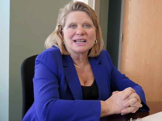 Secretary of State Ruth Johnson talks during an interview
