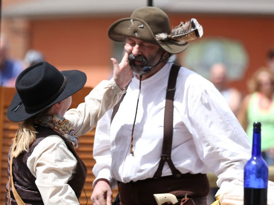 Members of the Guns of the Golden West reenact a scene from the wild west at the Fort Benton Summer Celebration.