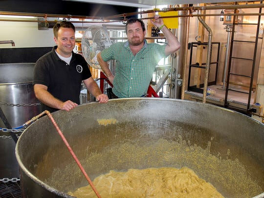 Brian McKenzie, owner and president of Finger Lakes Distilling, left, and Thomas McKenzie, master distiller, have grown the business several fold since opening to customers almost five years ago.