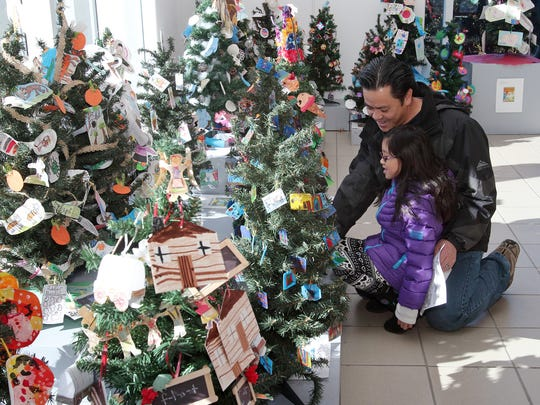 """Tin La of Succasunna checks out the """"Story Book Forest"""" with his daughter Kristina La, 7, at the Morris Museum in Morris Twp, NJ, on Saturday, January 17, 2015."""