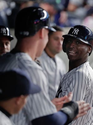 New York Yankees' Didi Gregorius, right, looks back to Aaron Judge, left, in the dugout after hitting a two-run home run against the Minnesota Twins during the fifth inning of a baseball game Tuesday, April 24, 2018, in New York.