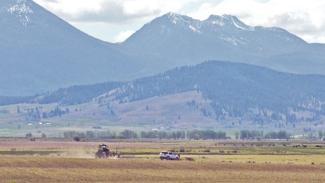 FILE - In this May 5, 2015 file photo, The Elkhorn Mountains shown here west of Baker City, Ore., are snow-free except at the highest elevations. With summer fast approaching, Oregon's primary water storage system, snowpack in the mountains, is a tiny fraction of normal, prompting forecasts of streamflows far below average, affecting farmers, whitewater outfitters, and future salmon returns. (Kathy Orr/The Baker City Herald via AP, File)