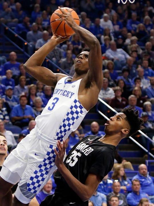 Kentucky's Hamidou Diallo (3) shoots as Harvard's Robert Baker (35) defends during the first half of an NCAA college basketball game, Saturday, Dec. 2, 2017, in Lexington, Ky. (AP Photo/James Crisp)