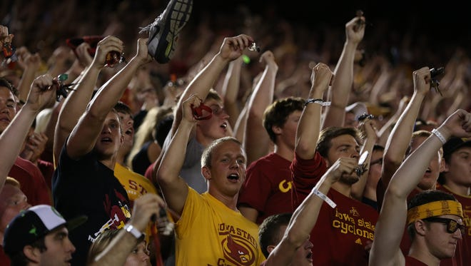 Iowa State fans cheer during a 2013 game against Texas at Jack Trice Stadium.