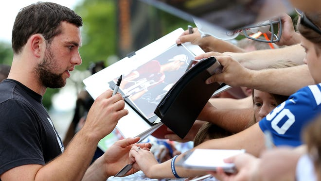 Indianapolis Colts quarterback Andrew Luck signs autographs for the fans on the first day of training camp, on Wednesday, July 23, 2014, at Anderson University.