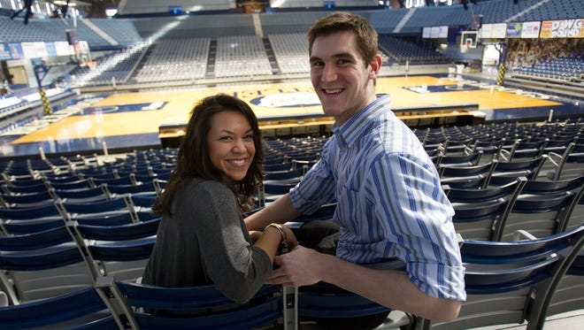 Andrew Smith and his wife Samantha Stage, in Hinkle Fieldhouse.