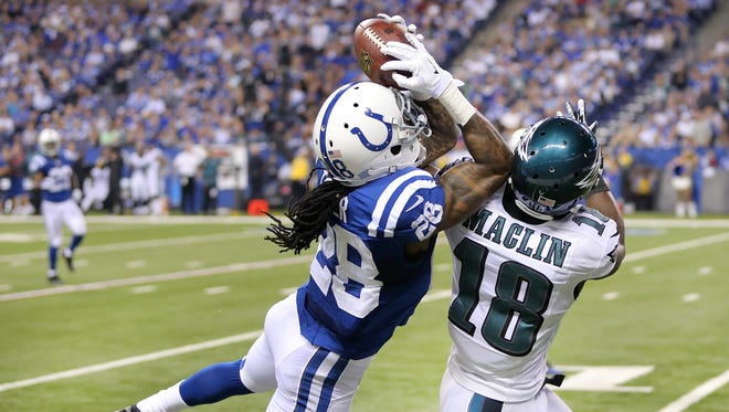 Indianapolis Colts Greg Toler intercepts the ball away from Philadelphia Eagles wide receiver Jeremy Maclin in the closing seconds of the first half. The Indianapolis Colts hosted the Philadelphia Eagles at Lucas Oil Stadium during Monday night's game on September 15, 2014.
