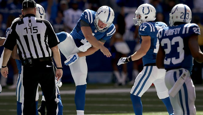 Indianapolis Colts Pat McAfee celebrates his onside kick to start the second quarter. The Indianapolis Colts played the Tennessee Titans Sunday. September 28, 2014, afternoon at Lucas Oil Stadium.