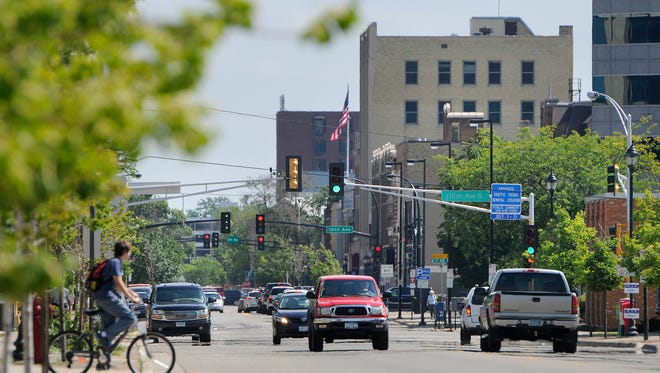 Traffic moves along St. Germain Street in downtown St. Cloud. The city has been ranked No. 7 on a list of fastest-growing American cities by NerdWallet, a financial literacy site.